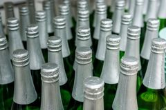 Close up champagne bottles in supermarket stock photography