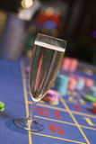 Close up of champagne glass on roulette table Royalty Free Stock Image