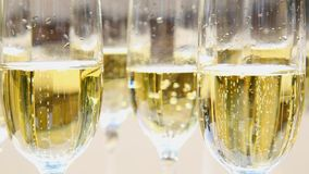 Close up of champagne in glasses stock video