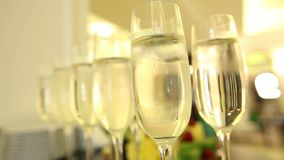 Close up of champagne glasses with celebration background. Close up of champagne glasses with celebration background, close up stock video footage