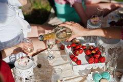 Close up champagne glasses on hands of friends at bachelorette p Royalty Free Stock Image
