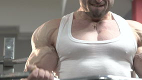 Close up champion of bodybuilding doing exercise. Slowly.  stock video