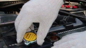 Change radiator cap of car. Close up change radiator cap of car stock video