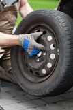 Close-up of a changing a car wheel Stock Photography