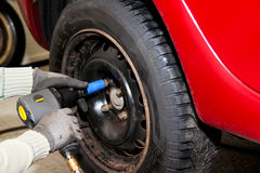 Close-up of changing wheel on car - with pneumatic Royalty Free Stock Images