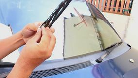 Changing wipers of a car. Close up changing wipers of a car stock footage
