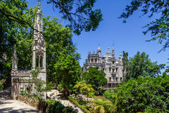 Close up of the Chapel with the Regaleira Palace and Gardens in background. Sintra, Portugal - July, 2015: Close up of the Chapel with the Regaleira Palace and Stock Images