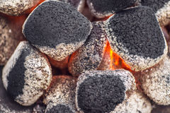 Close up of charcoal briquettes ready for barbecue grill, burning charcoal grill Royalty Free Stock Photography