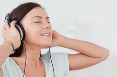 Close up of a charming brunette listening to music Royalty Free Stock Photo