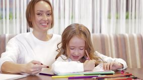 Close-up - Charming Mother And Daughter Drawing Together stock video footage