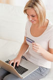 Close up of a charming woman buying online Stock Photography