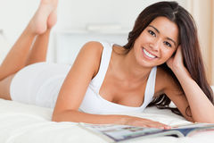 Close up of a charming woman lying on bed Stock Photography