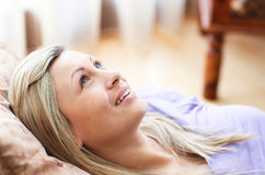 Close-up of a charming woman lying on a sofa Royalty Free Stock Photography