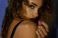 Close up of charming young girl with beautiful make up and curly hair Stock Photos