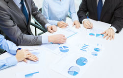 Close up of chats and graphs in office Stock Photo