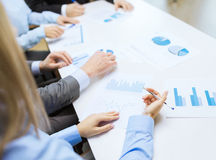 Close up of chats and graphs in office Stock Photos