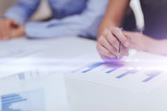 Close up of chats and graphs in office Stock Photography
