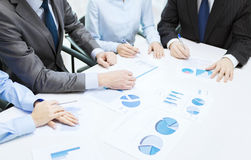 Close up of chats and graphs in office Royalty Free Stock Images
