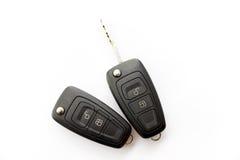Close up chave do carro em um branco Fotos de Stock Royalty Free