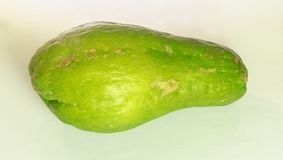 Close-up of a Chayote, called also christophine, cho-cho and pear squash. Closeup of a chayote, called also christophine, cho-cho and pear squash, is an edible royalty free stock image