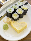 Close up cheap Sushi with egg-roll heart shape. Bangkok, Thailand - Aug 13, 2014 : Close up cheap Sushi with egg-roll heart shape Royalty Free Stock Photography