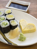 Close up cheap Sushi with egg-roll heart shape. Bangkok, Thailand - Aug 13, 2014 : Close up cheap Sushi with egg-roll heart shape Royalty Free Stock Image