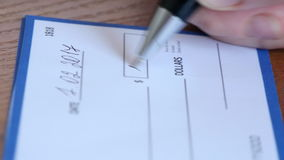 Close up of check being signed stock footage