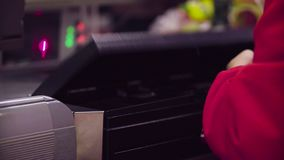Woman working on cash register in the store. Close up check out counter. Hands of woman working on cash register in the supermarket stock footage