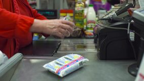 Senior woman working on cash register. Close up check out counter. Senior female hands working on cash register in the supermarket stock video