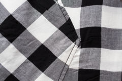 Close up of checkered clothing item with pocket. Clothes and textile concept - close up of checkered clothing item with pocket Royalty Free Stock Image