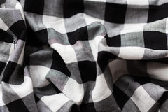 Close up of checkered fabric or clothing item. Textile and clothes concept - close up of checkered fabric or clothing item Stock Images