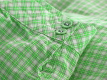 Close up of a checkered shirt cuff. Close up of a checkered shirt cuff showing stiches and buttons. Pyjama style Royalty Free Stock Photo