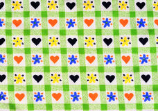 Close up on checkered tablecloth fabric with cute design. Stock Image