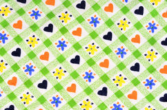 Close up on checkered tablecloth fabric with cute design. Royalty Free Stock Image