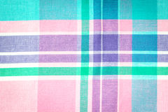 Close up on checkered tablecloth fabric, pink, green, violet wit Stock Photo