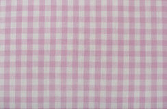 Close up on checkered tablecloth fabric. Stock Photos