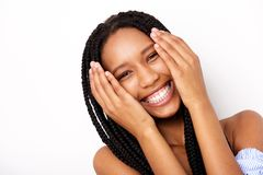 Close up cheerful african american young woman with hands by face against white background. Close up portrait of cheerful african american young woman with hands Royalty Free Stock Image