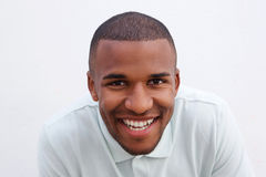Close up cheerful african man smiling on white background. Close up portrait of cheerful african man smiling on white background Royalty Free Stock Photography