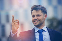 Close up of cheerful businessman gesturing Stock Image