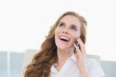 Close up of cheerful businesswoman using cellphone Royalty Free Stock Photography