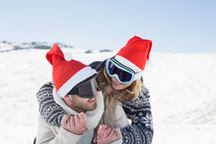 Close up of a cheerful couple in ski goggles on snow Royalty Free Stock Photo