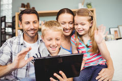 Close-up of cheerful family using technologies Royalty Free Stock Images
