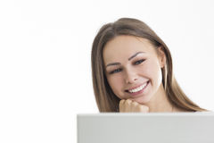 Close up of cheerful girl against white wall Stock Image