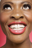 Close up of cheerful woman looking up Royalty Free Stock Images