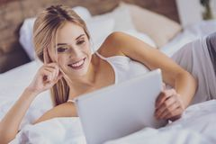Close up of cheerful woman watching funny video on tablet stock photos