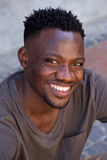 Close up cheerful young african man smiling Royalty Free Stock Photo