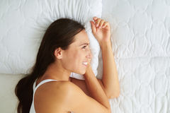 Close-up of cheerful young beautiful woman lying on the side Stock Photo