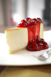 Close up cheese cake and cherry sauce Royalty Free Stock Image