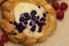 Close up of cheese danish puff pastry with blackberries and fresh raspberries.  Royalty Free Stock Image