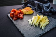 Close-up Cheese pieces and apple on slate board royalty free stock photos